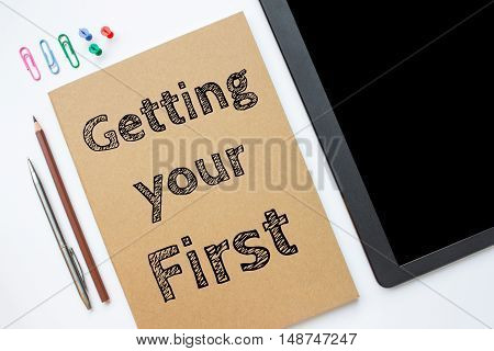 Text Getting your first on white paper book on table / business concept