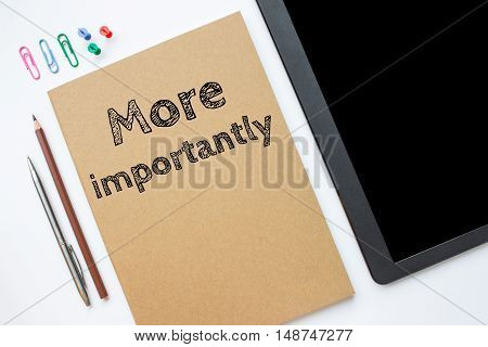 Text more importantly on brown paper book on table / business concept