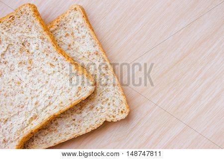 bread on wood table background / copy space / top view