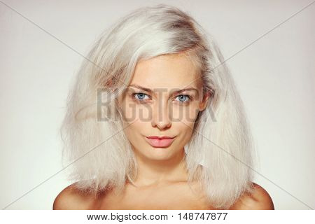 Vintage style portrait of young beautiful girl with platinum blond bleached hair and no make-up