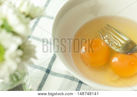 egg prepare for cooking, on the tablecloth and mum flower