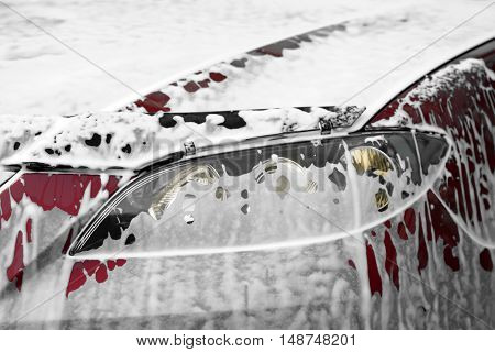 Car washing concept. Car in foam