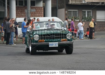 BELGRADE,SERBIA - SEPTEMBER 10, 2016: Old Triumph TR6 at the commercial race of old cars in memory of formula 1 race held on the same place in 1939 two days after the beginning of Second World War when the famous Italian driver Tazio Nuvolari won