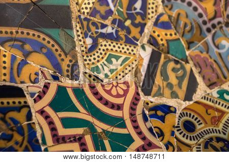 Closeup of colorful ceramic patterned mosaic tile at Antoni Gaudis' Park Guell, Barcelona, Spain, Europe