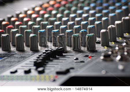 Closeup of an audio mixer with blurs