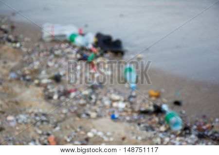 Pollution at the beach with blurred background
