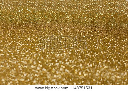 Gold glitter background lens bokeh effect golden spot backdrop blur brown bubble banner abstract soft circle dot sceneAbstract Christmas background