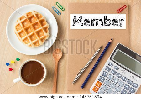 Member, text message on paper book and office supplies, pen, coffee on wood desk , copy space / business concept / view from above, top view