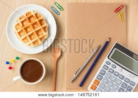 paper book and office supplies, pen, coffee on wood desk , copy space / business concept / view from above, top view