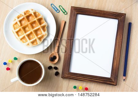 blank wood frame board and office supplies, pencil, coffee on wood desk , copy space / business concept / view from above, top view