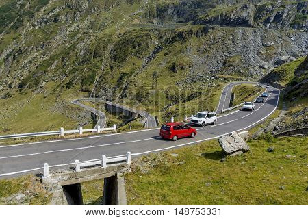 Car traffic on Transfagarasan mountain winding road, from Carpathian mountains in Romania.