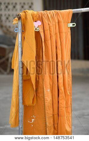 close up yellow robe in public temple thailand