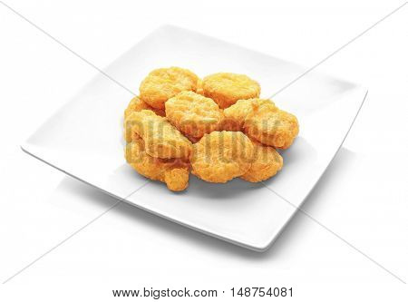 Tasty chicken nuggets on plate, isolated on white