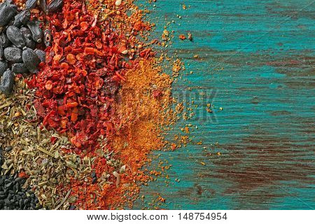 Mix of different spices on wooden background