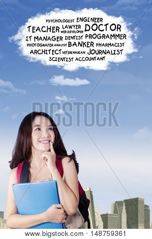 Picture of a pretty teenage girl imagines her future jobs while looking at cloud speech