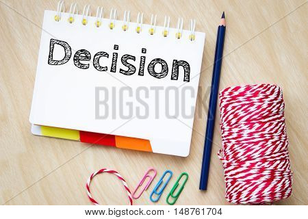 Decision, text message on white paper and pencil on wood table / business concept
