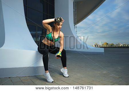 Attractive Fitness Girl Do Workout At Modern Urban Area Sunset