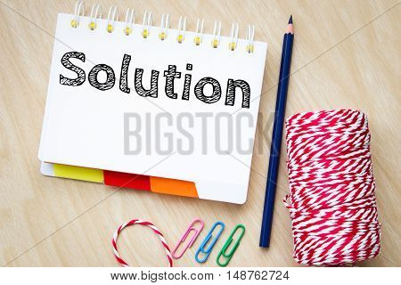 solution, text message on white paper and pencil on wood table / business concept