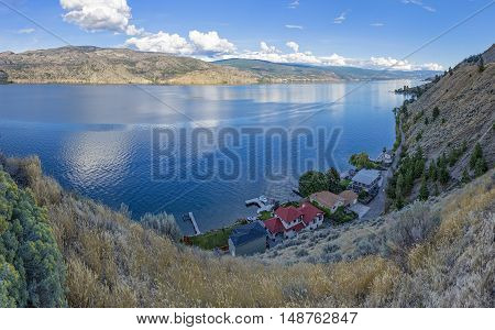 Okanagan Lake near Summerland British Columbia Canada with a lakefront subdivision in the Foreground