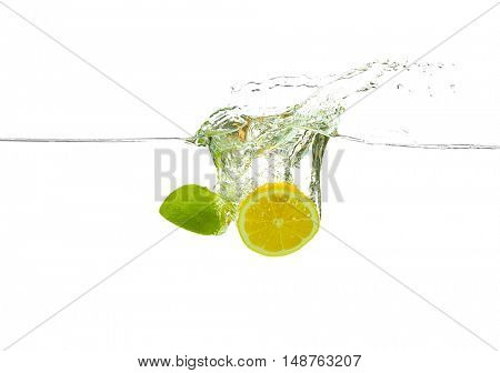 Fruits  falling into water on white background