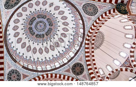 ISTANBUL, TURKEY - OCTOBER 31, 2015: Ceiling decoration of Sehzade Mosque built in 1548 by Mimar Sinan
