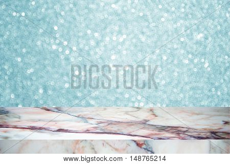 white marble stone countertop or table on blue blurred abstract background / for display or montage your products