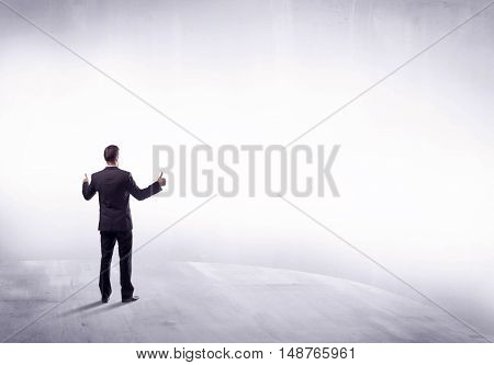 Young sales businessman in elegant suit standing with his back in empty white space background concept