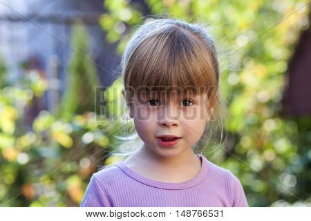 Portrait of little girl with surprised expression on face