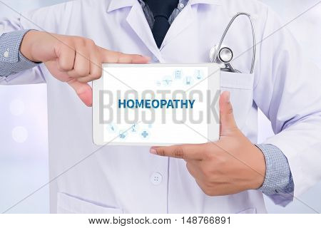 HOMEOPATHY Doctor holding digital tablet doctor work hard