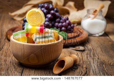 Colorful Jelly Candies In Wooden Bowl.