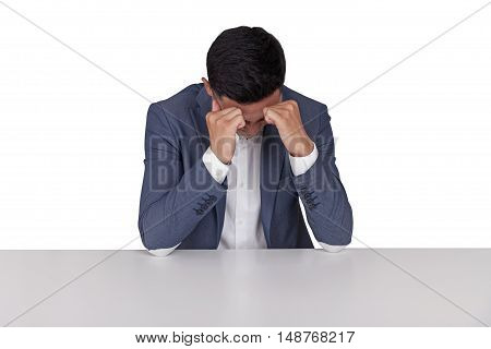 Isolated portrait of stressed Asian businessman overwhelmed with the amount of work he is supposed to do. Concept of overworking.