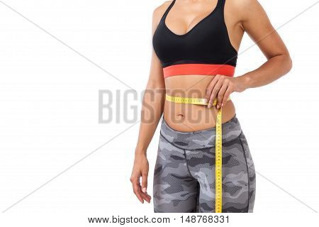 Close Up Of Waist Measuring Girl