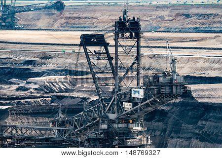 GARZWEILER, GERMANY - SEPTEMBER 16, 2016: Huge Excavator mines in an opencast mining field