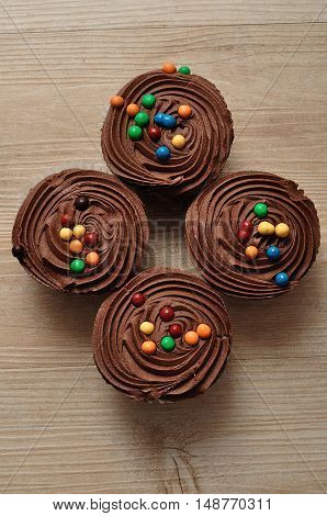 Chocolate Cupcakes with chocolate frosting and decorated with colorful candy