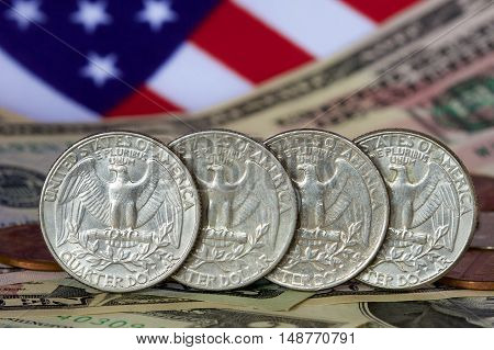 American quarter dollars with notes and a flag.