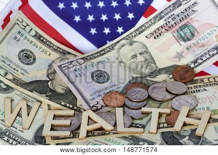 Wealth signage with American notes, coins and a flag.