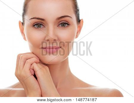 Portrait of beautiful young woman with perfect skin on white background