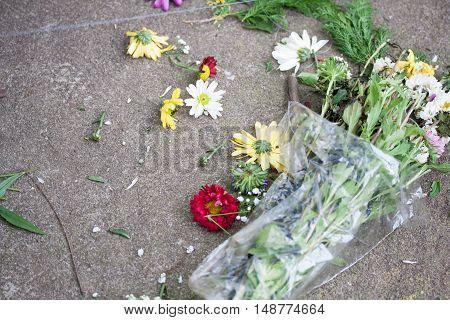 Dismatled flower bouquet thrown away on the floor