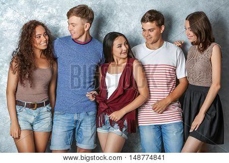 Happy friends on grey background