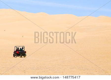 WINTERHAVEN, CALIFORNIA, USA - MAY 26, 2015: Two people driving around in the Algodones Dunes with a buggy.
