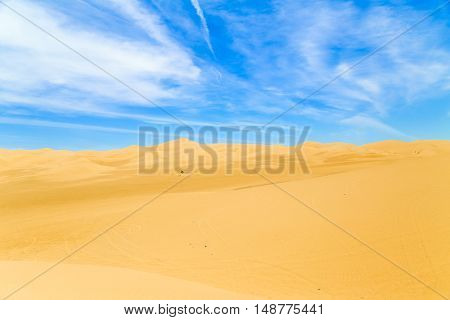 The Algodones Dunes near Winterhaven in California USA with blue sky and some light clouds.