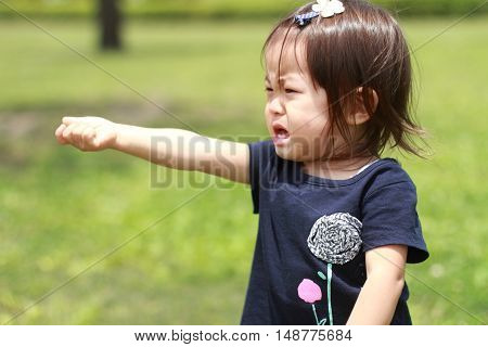 Crying small Japanese girl (1 year old)