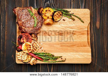 Roasted organic shin of beef meat on wooden table