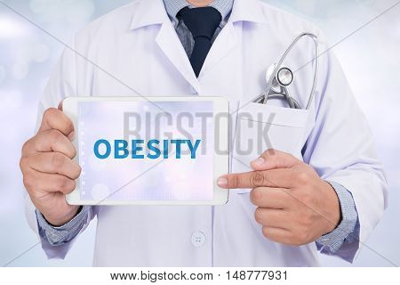 OBESITY Doctor holding digital tablet doctor work to touch hand