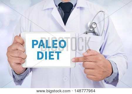 PALEO DIET Doctor holding digital tablet doctor work to touch hand