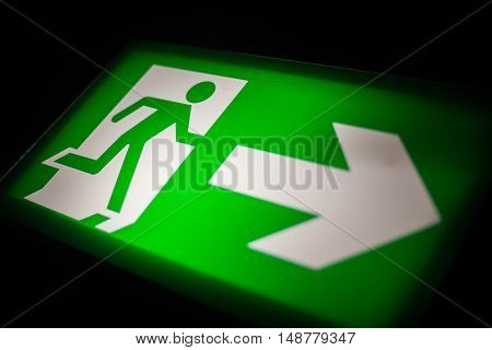 Close up shot of an emergency exit sign.
