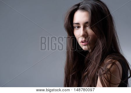 beauty and skincare concept, portrait of a attractive brunette looking into camera with copyspace
