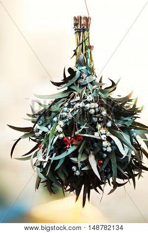 Christmas mistletoe plant bunch as Christmas symbol hanging on market in Europe. Omela