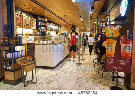 HONG KONG - SEPTEMBER 02, 2016: Starbucks inside the ifc mall in Hong Kong. Starbucks Corporation is an American coffee company and coffeehouse chain.