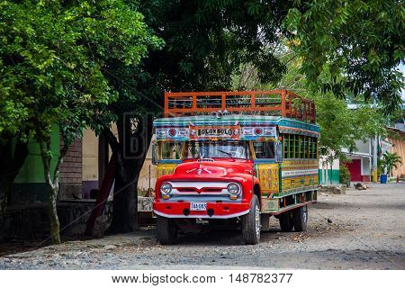 Bolombolo, Colombia - June 30,  2016: Colorful traditional rural bus from Colombia called chiva